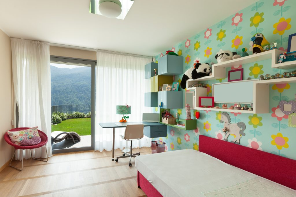 Wallpaper covering in child's room by Gavin Lambert Decorators